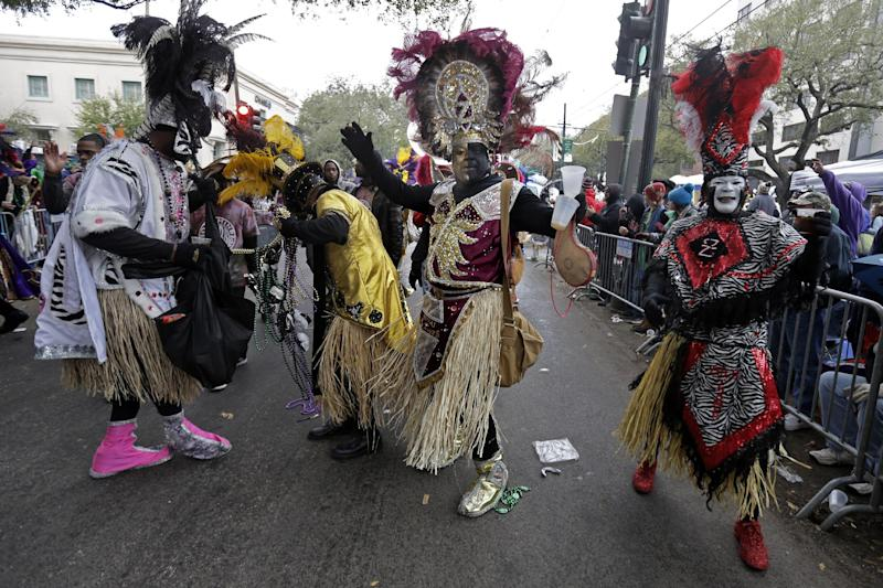 Members of the Krewe of Zulu march during Mardi Gras day in New Orleans, Tuesday, March 4, 2014. The Zulu parade began on schedule, led by a New Orleans police vanguard on horseback that included Mayor Mitch Landrieu. (AP Photo/Gerald Herbert)