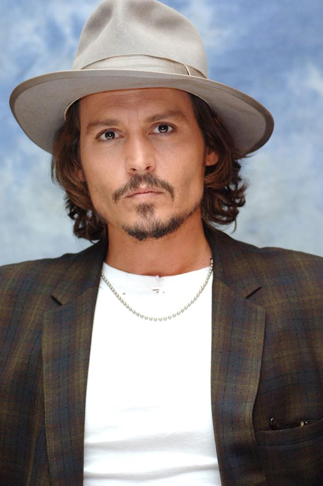 Johnny Depp is wearing a fedora. In the early 20th century, the fedora was actually a popular hat for women. Then later it became popular headgear for men. Either way, he rocks it.