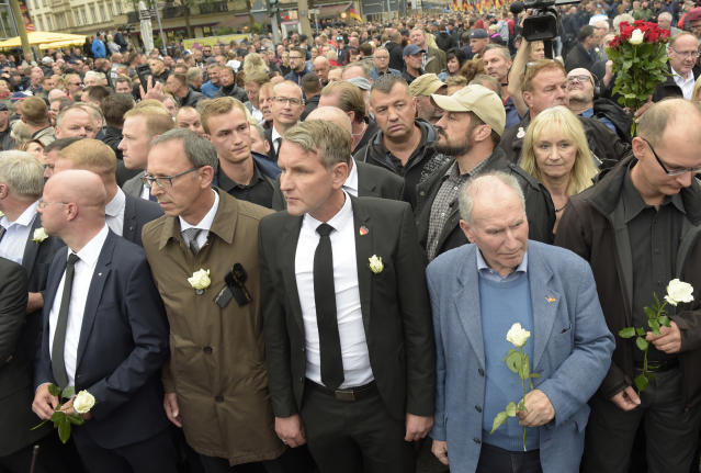 <p>Bjoern Hoecke, center, leader of the Alternative for Germany, AfD, in German state of Thuringia, participates in a commemoration march in Chemnitz, eastern Germany, Saturday, Sept. 1, 2018, after several nationalist groups called for marches protesting the killing of a German man last week, allegedly by migrants from Syria and Iraq. (Photo: Jens Meyer/AP) </p>
