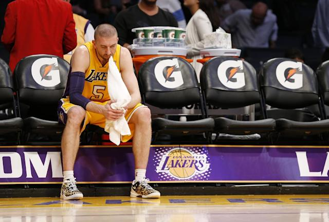 Los Angeles Lakers' Steve Blake sits along on the bench with a towel in his mouth after the Lakers lost to the Utah Jazz 96-79 in an NBA basketball game in Los Angeles, Tuesday, Feb. 11, 2014. (AP Photo/Danny Moloshok)