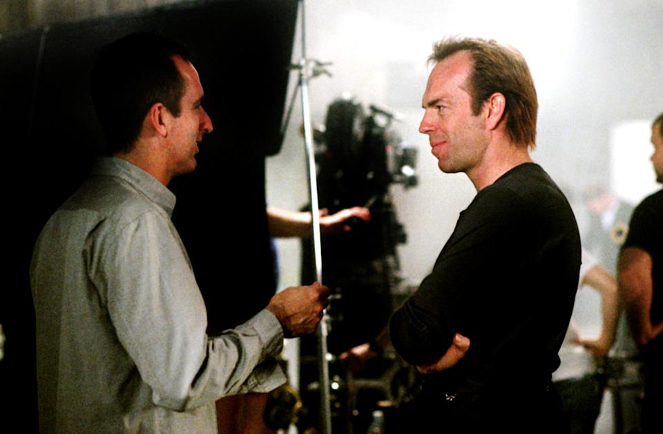 Director James McTeigue and a maskless Hugo Weaving on the set of 'V for Vendetta' (Photo 2006: Warner Brothers/courtesy Everett Collection)