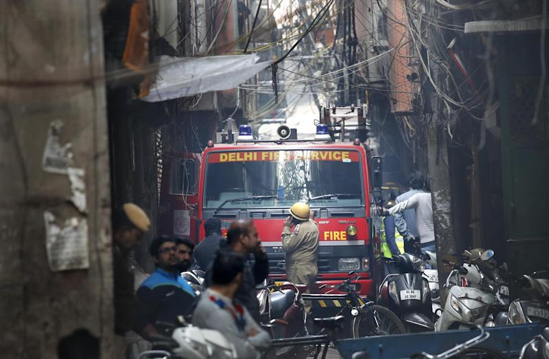 A fire engine outside a factory that suffered a blaze: AP