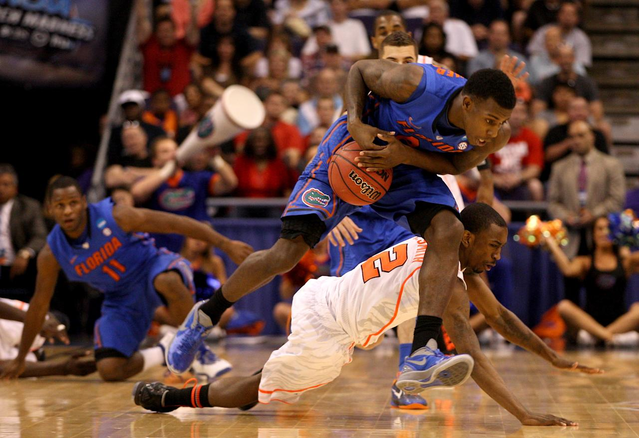 PHOENIX, AZ - MARCH 24:  Casey Prather #24 of the Florida Gators grabs the ball in front of Russ Smith #2 of the Louisville Cardinals in the second half during the 2012 NCAA Men's Basketball West Regional Final at US Airways Center on March 24, 2012 in Phoenix, Arizona.  (Photo by Christian Petersen/Getty Images)