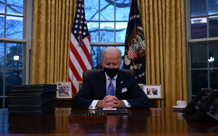 US President Joe Biden signed a raft of executive orders to launch his administration, including a decision to rejoin the Paris climate accord - Jim Watson/AFP