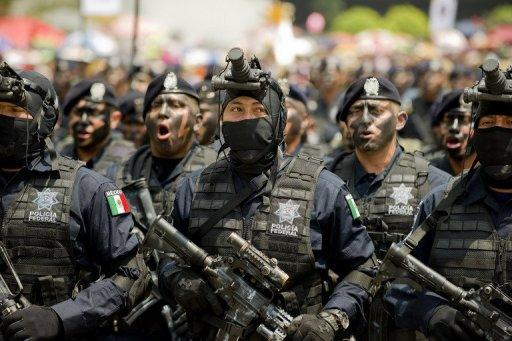 Mexican Federal Police members march along Juarez Avenue in Mexico City on September 16, 2012