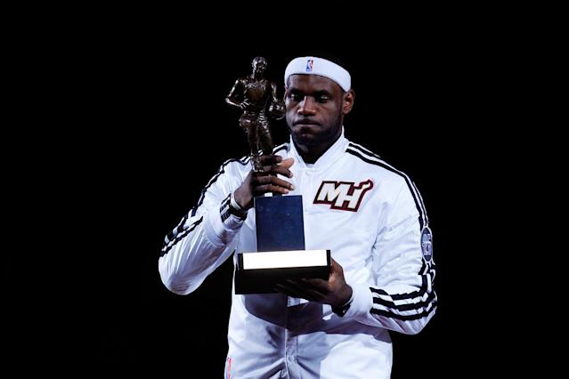 MIAMI, FL - MAY 06: LeBron James #6 of the Miami Heat poses with the 2013 NBA MVP trophy prior to Game One against the Chicago Bulls in the Eastern Conference Semifinals of the 2013 NBA Playoffs at American Airlines Arena on May 6, 2013 in Miami, Florida. NOTE TO USER: User expressly acknowledges and agrees that, by downloading and/or using this photograph, user is consenting to the terms and conditions of the Getty Images License Agreement. (Photo by Chris Trotman/Getty Images)