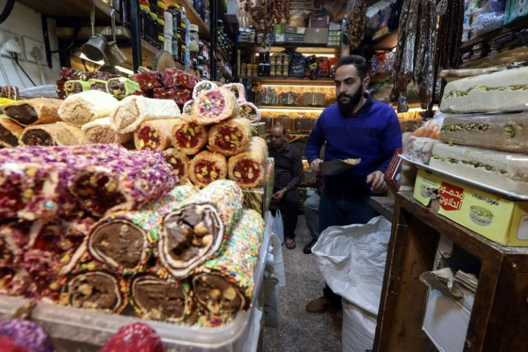 An Iraqi man sells nuts in the old bazaar in Arbil, the capital Iraqi Kurdistan: shopkeepers offer the tradition of istiftah to the first customer of the day