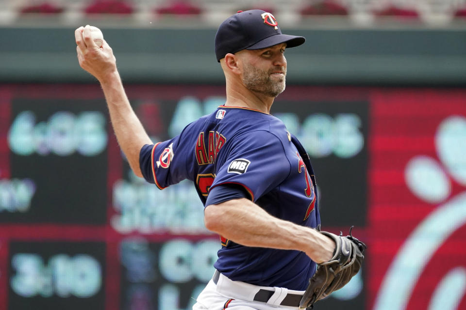 Minnesota Twins' pitcher J.A. Happ throws against the Detroit Tigers in the first inning of a baseball game, Wednesday, July 28, 2021, in Minneapolis. (AP Photo/Jim Mone)