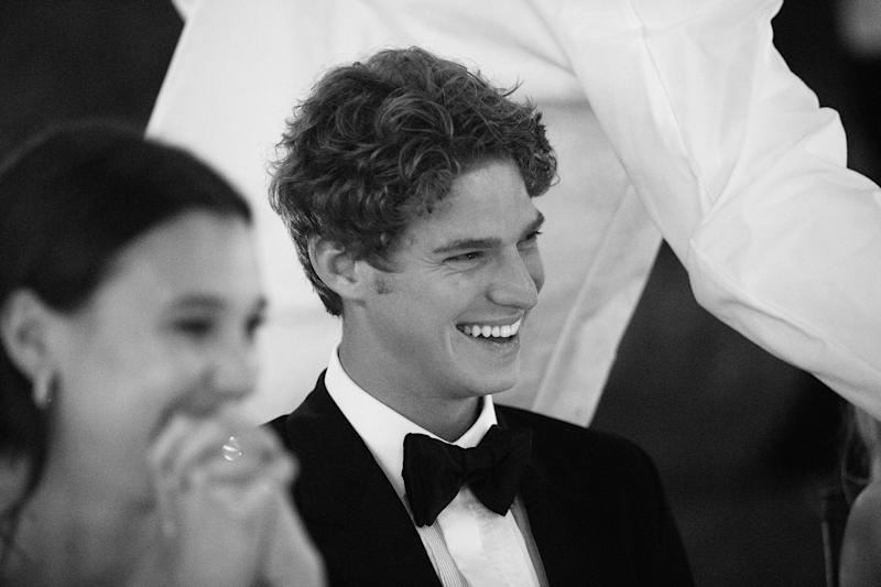 An effervescent smile from my brother, Dylan, as our friends give their toasts.