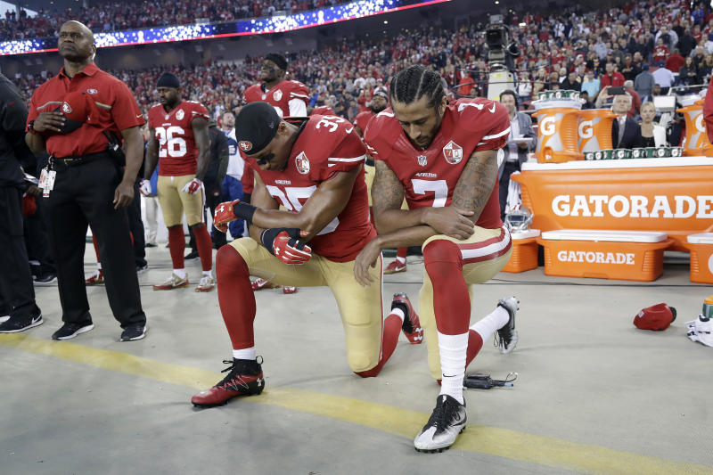 FILE - In this Sept. 12, 2016, file photo, San Francisco 49ers safety Eric Reid (35) and quarterback Colin Kaepernick (7) kneel during the national anthem before an NFL football game against the Los Angeles Rams in Santa Clara, Calif. When Colin Kaepernick took a knee during the national anthem to take a stand against police brutality, racial injustice and social inequality, he was vilified by people who considered it an offense against the country, the flag and the military. (AP Photo/Marcio Jose Sanchez, File)