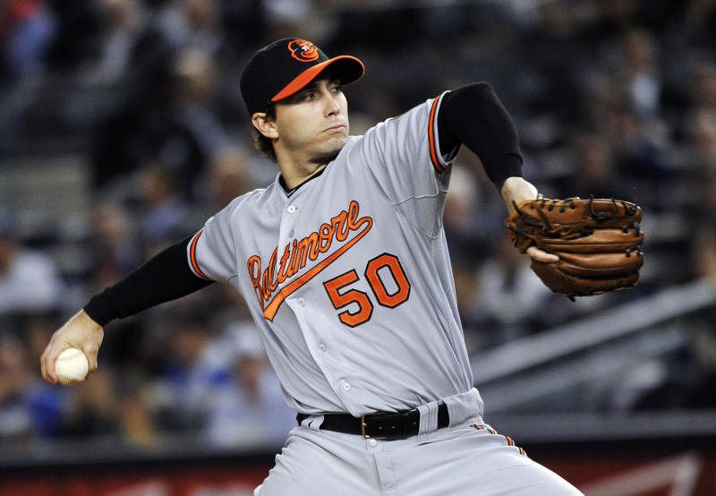 Baltimore Orioles' Miguel Gonzalez delivers a pitch during the first inning of Game 3 of the Orioles' American League division baseball series against the New York Yankees, Wednesday, Oct. 10, 2012, in New York. (AP Photo/Bill Kostroun)