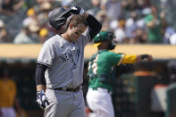 New York Yankees' Anthony Rizzo reacts after striking out against the Oakland Athletics during the sixth inning of a baseball game in Oakland, Calif., Saturday, Aug. 28, 2021. (AP Photo/Jeff Chiu)