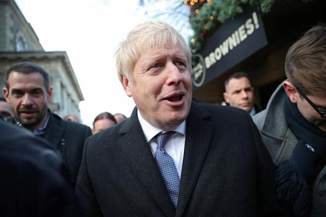 Britain's prime minister Boris Johnson visits a Christmas market in Salisbury, England, on 3 December. Photo: Hannah McKay/Reuters