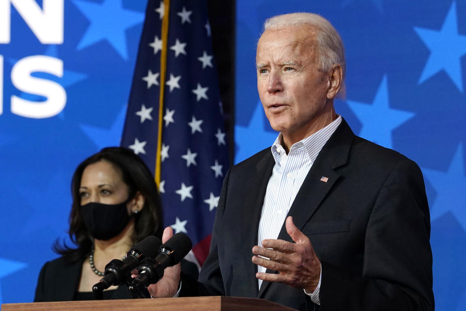 Democratic presidential candidate former Vice President Joe Biden speaks Thursday, Nov. 5, 2020, in Wilmington, Del. Democratic vice presidential candidate Sen. Kamala Harris, D-Calif., stands at left. (AP Photo/Carolyn Kaster)