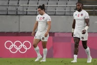Madison Hughes, left, of the United States and teammate Matai Leuta react after the U.S. team lost to Britain in their men's rugby sevens quarterfinal match at the 2020 Summer Olympics, Tuesday, July 27, 2021, in Tokyo. (AP Photo/Shuji Kajiyama)