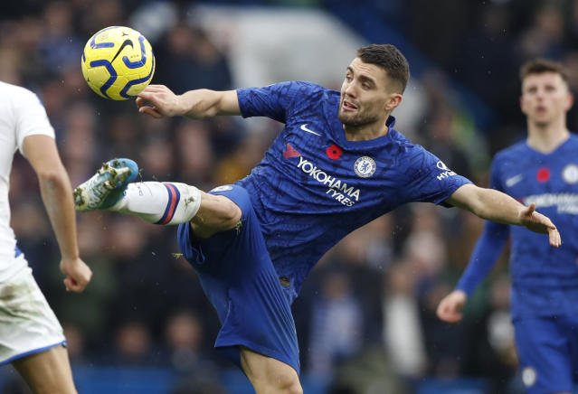 Chelsea's Mateo Kovacic controls the ball during the English Premier League soccer match between Chelsea and Crystal Palace at Stamford Bridge stadium in London, Saturday, Nov. 9, 2019. (AP Photo/Alastair Grant)