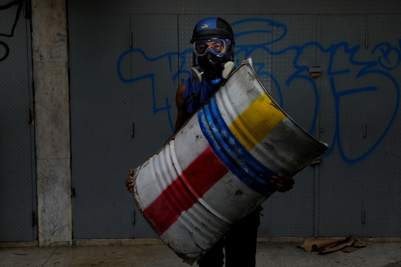 "<p>A demonstrator holding a rudimentary shield poses for a picture before a rally against Venezuelan President Nicolas Maduro's government in Caracas, Venezuela, June 17, 2017. He said: ""I protest for freedom. I fight for freedom of speech."" (Photo: Carlos Garcia Rawlins/Reuters) </p>"