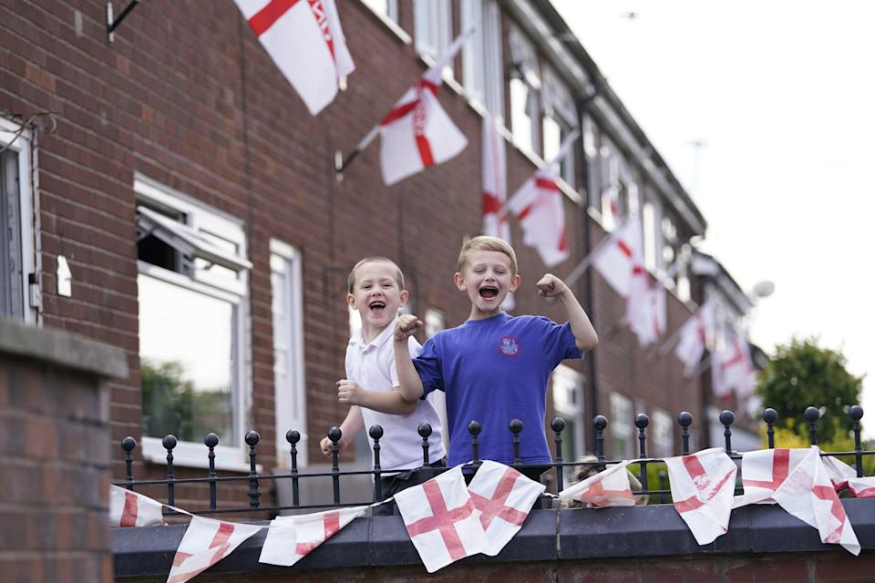 Noah Butterworth (left) and Harry Chamberlain on Wales Street in Oldham, where residents have renamed the road England Street ahead of the final (PA Wire)