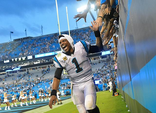 Cam Newton certainly had his admirers in Charlotte, particularly when the team was rolling. (Photo by Grant Halverson/Getty Images)