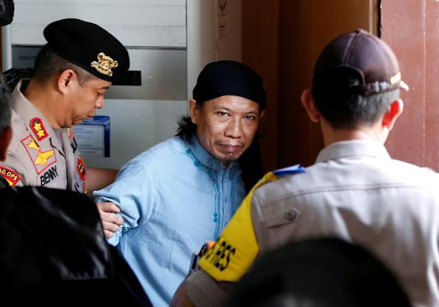 Islamic cleric Aman Abdurrahman leaves a court following his verdict in Jakarta, Indonesia, June 22, 2018. REUTERS/Darren Whiteside TPX IMAGES OF THE DAY