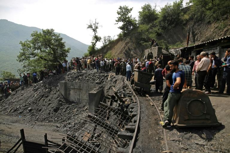 Iranians and rescue workers gather at the scene following an explosion in a coal mine in Azadshahr, in northern Iran, on May 3, 2017. Twenty-one miners died trying to rescue trapped workmates and an official said there was little hope of finding survivors