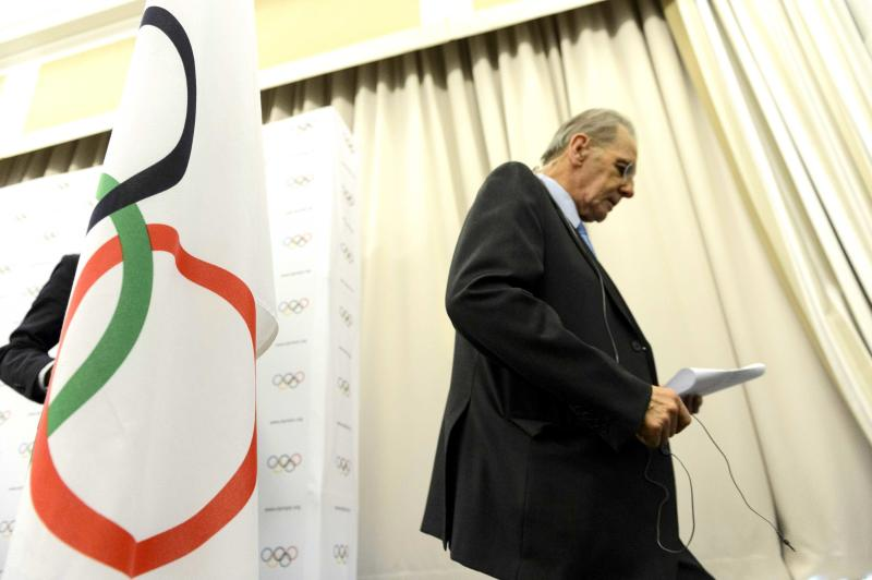 International Olympic Committee, IOC, President Jacques Rogge leaves a press conference after the last day of the executive board's meeting, in Lausanne, Switzerland, Wednesday, Feb. 13, 2013. IOC President Jacques Rogge says he will meet with the head of wrestling's governing body to discuss ways the sport can fight to save its place in the 2020 Olympics. The IOC executive board dropped wrestling from the program of the 2020 Games on Tuesday, removing it from the list of 26 sports contested at last year's London Olympics. The decision, which still must be ratified by the full IOC in September, has been widely criticized by wrestling organizations around the world.  Rogge says he has been contacted by Raphael Martinetti, the president of international wrestling federation FILA.   (AP Photo/Keystone,/Laurent Gillieron)