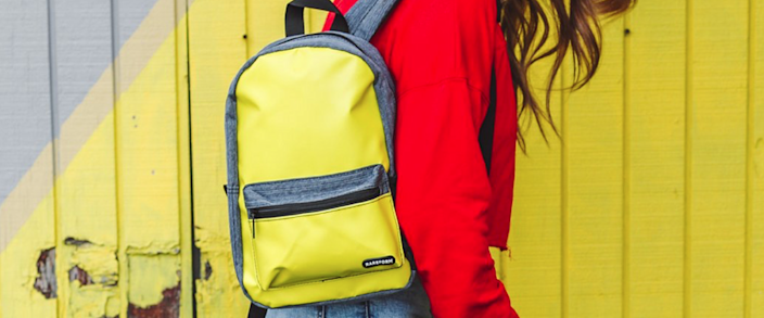 A vivid yellow backpack from sustainable surf apparel company Rareform.