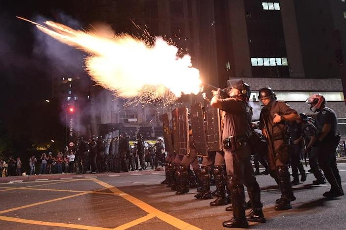 Police fire tear gas grenades at supporters of suspended Brazilian President Dilma Rousseff holding a demonstration during her impeachment trial in Sao Paulo, Brazil on August 29, 2016 (AFP Photo/Nelson Almeida)