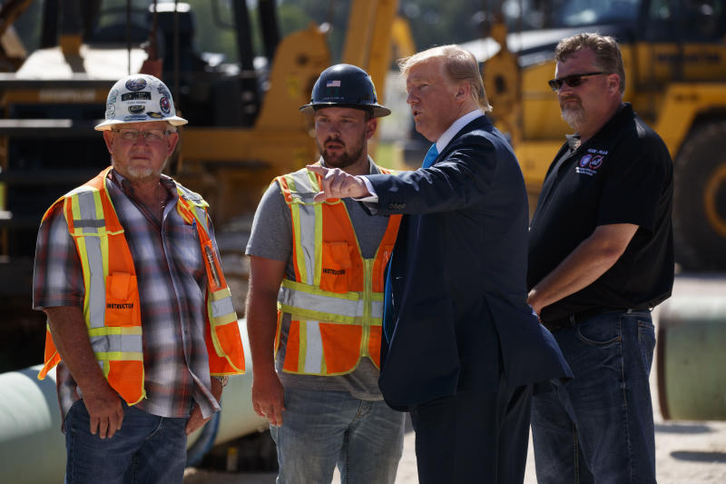 President Donald Trump takes a tour before speaking about energy and infrastructure at the International Union of Operating Engineers International Training and Education Center, Wednesday, April 10, 2019, in Crosby, Texas. (AP Photo/Evan Vucci)