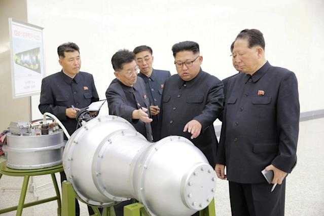 <p>North Korean leader Kim Jong Un provides guidance with Ri Hong Sop (2nd L) and Hong Sung Mu (R) on a nuclear weapons program in this undated photo released by North Korea's Korean Central News Agency in Pyongyang September 3, 2017. (Photo: KCNA/via Reuters) </p>