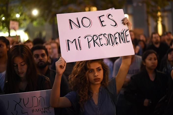 """<p>Kimmy, who declined to give a last name, rallies with protesters in Oakland, California, U.S. following the election of Donald Trump as President of the United States November 9, 2016. The sign reads: """"He is not my president"""". (REUTERS/Noah Berger) </p>"""