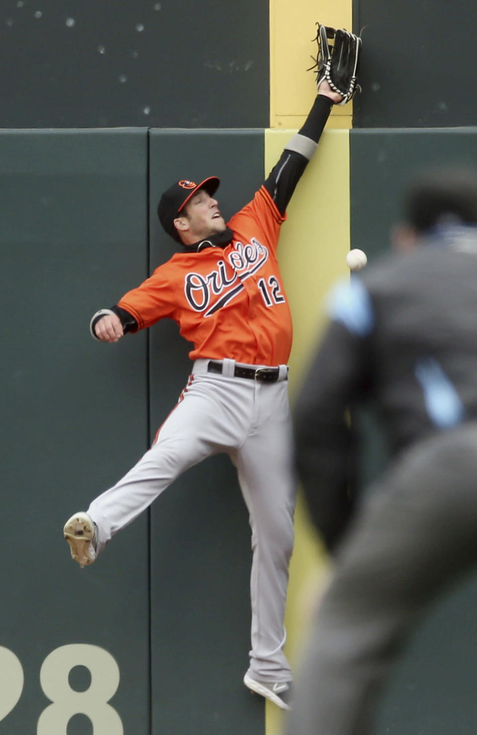 Baltimore Orioles' Trey Mancini tries but fails in his attempt to catch a foul ball off the bat of Minnesota Twins' Jorge Polanco in the third inning of a baseball game Saturday, April 27, 2019, in Minneapolis. (AP Photo/Jim Mone)