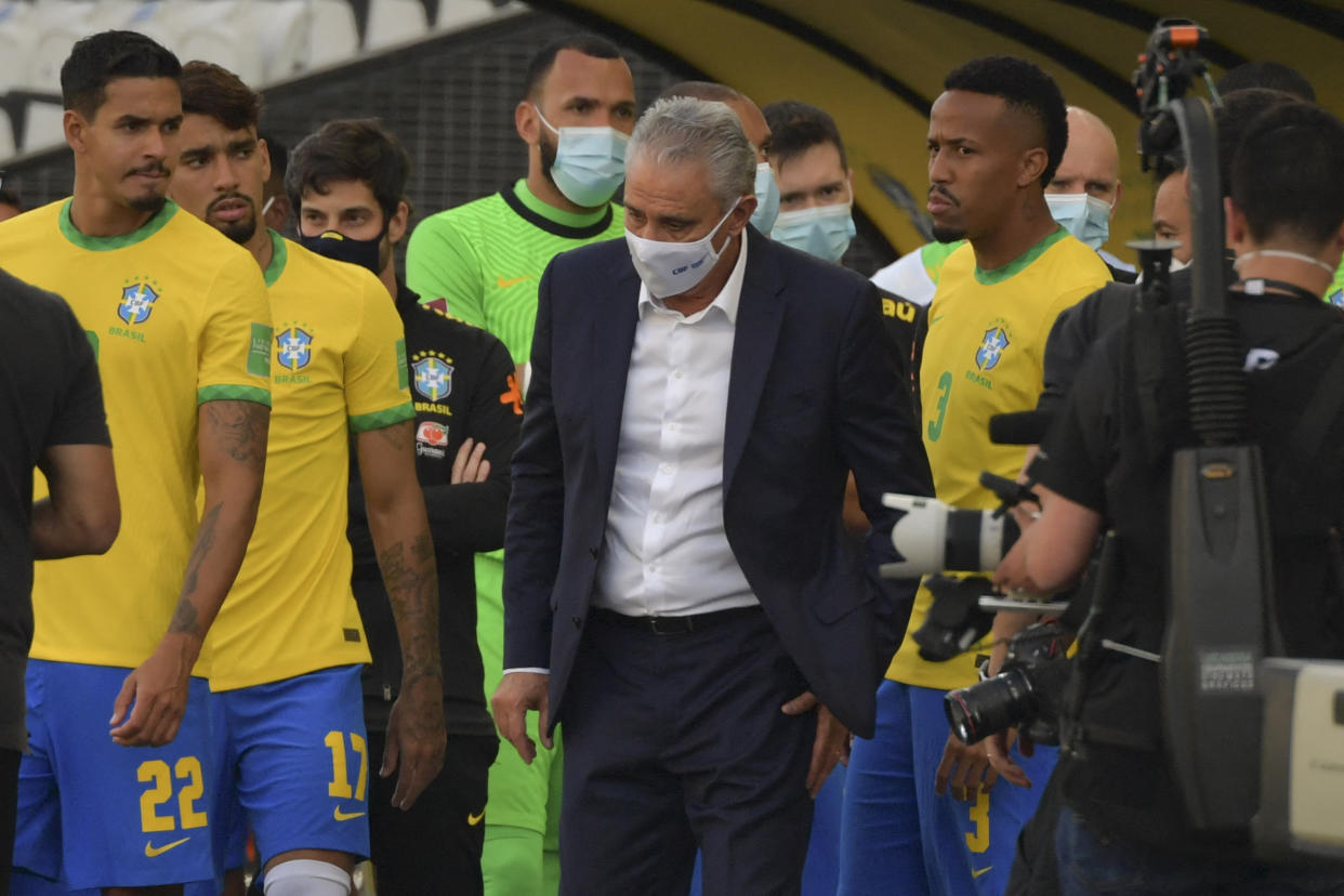 Brazil's coach Tite (C) is seen after employees of the National Health Surveillance Agency (Anvisa) entered to the field during the South American qualification football match for the FIFA World Cup Qatar 2022 between Brazil and Argentina.
