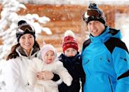 <p>The whole family posed for a photo in the snow during their break, too.</p>