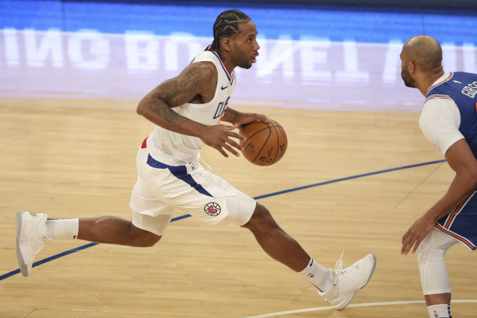 Los Angeles Clippers small forward Kawhi Leonard (2) controls the ball against New York Knicks center Taj Gibson (67) during the first half of an NBA basketball game Sunday, Jan. 31, 2021, in New York. (Brad Penner/Pool Photo via AP)