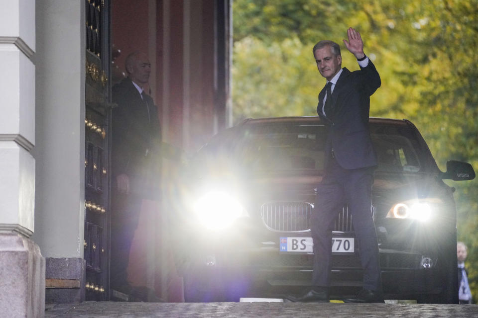 Norway's prime minister-designate Jonas Gahr Store waves to the media as he leaves after an audience at the Royal Palace in Oslo, Thursday Oct. 14, 2021. Norway's Conservative Prime Minister Erna Solberg will step down as head of a three-party, minority center-right government after the left-leaning bloc won last month's parliament election. (Ole Berg-Rusten/NTB via AP)