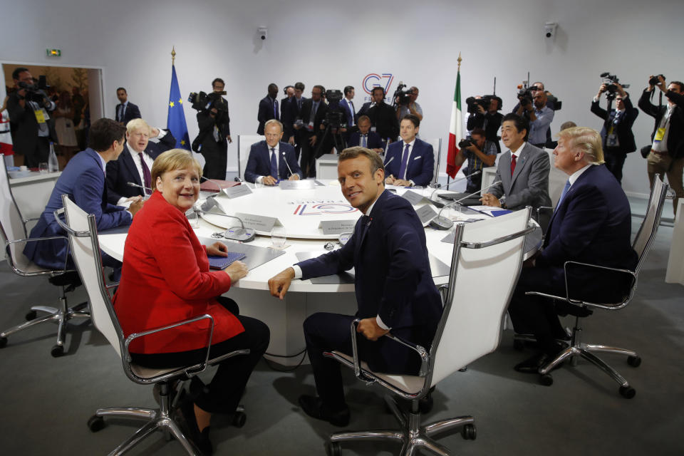 FILE - In this Aug. 25, 2019, file photo, French President Emmanuel Macron, center, U.S. President Donald Trump, right, Japan's Prime Minister Shinzo Abe, second right, Britain's Prime Minister Boris Johnson, second left, German Chancellor Angela Merkel , center left, Canada's Prime Minister Justin Trudeau, Italy's Prime Minister Giuseppe Conte, rear right, and European Council President Donald Tusk attend a session during the G7 summit in Biarritz, southwestern France. Helping countries recover from the coronavirus pandemic will be at the top of the agenda for the Group of Seven summit when Johnson welcomes President Joe Biden and the leaders of France, Germany, Italy, Japan and Canada to the cliff-ringed Carbis Bay beach resort in southwestern England on Friday, June 11. (Philippe Wojazer/Pool via AP, File)