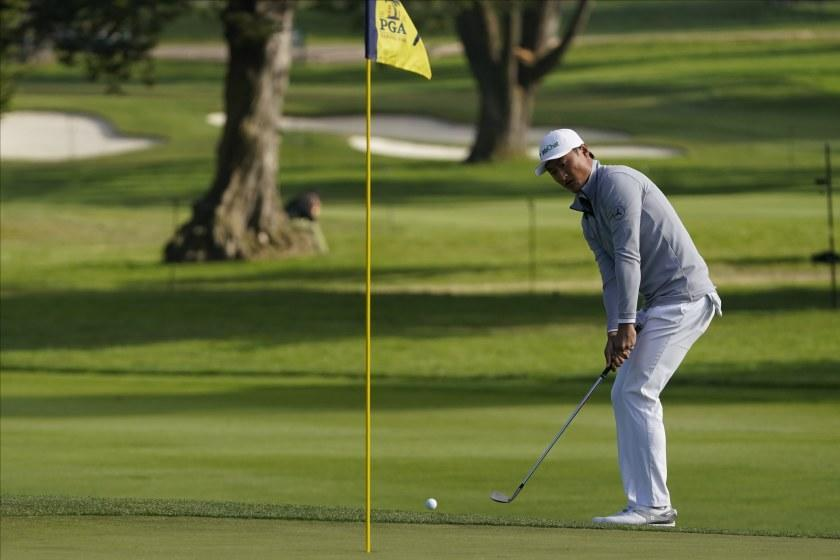 Haotong Li of China, chips to the green on the seventh hole during the second round of the PGA Championship.