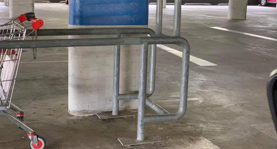 Source: A close up shot of the trolley bay that shows the metal bar placed incorrectly