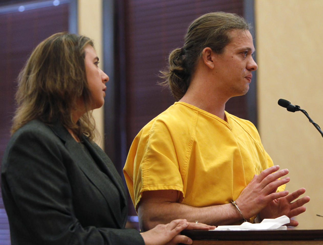 Dylan Stanley Dougherty, 27, pleads for a lighter sentence as he stands with his attorney Cobea Becker, left, in district court where he was sentenced to 32 years in prison on charges stemming from the shootout and capture of him and his brother and sister in Colorado in Walsenburg, Colo., on Monday, April 30, 2012. All three siblings were sentenced on Monday. Dougherty's sister Lee Grace Dougherty received a 24-year prison term, while his brother Ryan Dougherty, 22, was sentenced to 18 years in prison. The three are accused of shooting at a police officer and staging a daring bank robbery in a cross-country crime spree that included Georgia and Florida. The manhunt for them ended after an Aug. 10 freeway chase and shootout with police in southern Colorado. (AP Photo/Ed Andrieski)