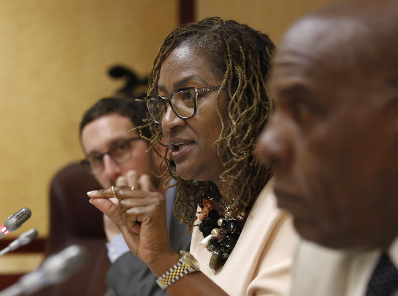 State Sen. Holly Mitchell, D-Los Angeles, discusses a law enforcement training bill by state Sen. Anna Caballero, D-Salinas, during a hearing at the Capitol Tuesday, April 23, 2019, in Sacramento, Calif. Lawmakers worked to find common ground between law enforcement organizations, which support Caballero's bill and reformers supporting a competing measure, by Democratic Assemblywoman Shirley Weber, that would adopt the first-in-the-nation standards designed to limit fatal shootings by police. (AP Photo/Rich Pedroncelli)