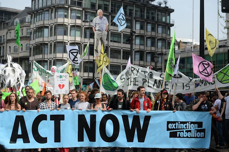 Extinction Rebellion protesters march from their camp in Marble Arch (PA)