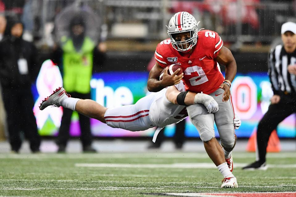 COLUMBUS, OH - OCTOBER 26:  J.K. Dobbins #2 of the Ohio State Buckeyes runs with the ball against the Wisconsin Badgers at Ohio Stadium on October 26, 2019 in Columbus, Ohio.  (Photo by Jamie Sabau/Getty Images)
