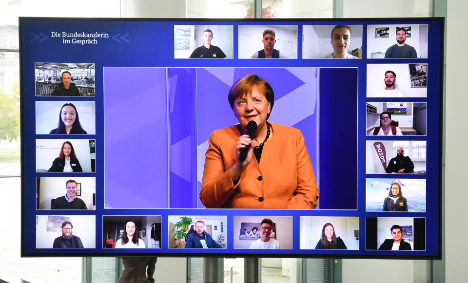 German chancellor Angela Merkel takes part in a 'Citizen Dialogue' with young job trainees on 12 November. Photo: John Macdougall/Getty Images