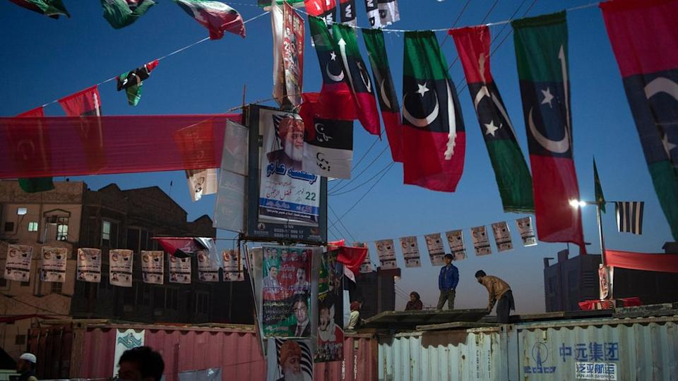 Workers decorate the venue for Pakistan Democratic Movement protest