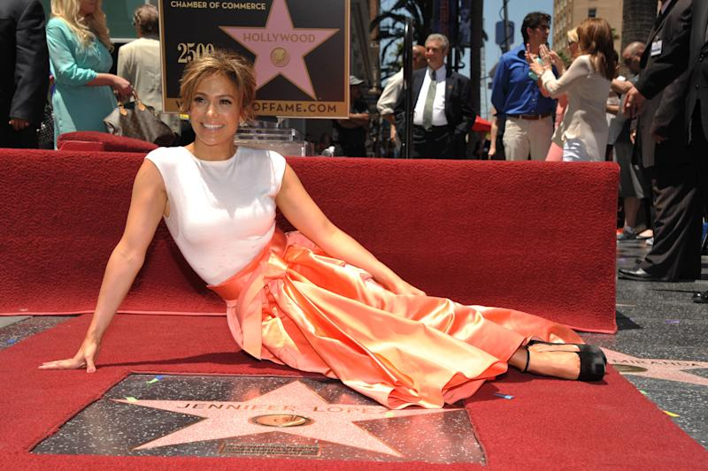 Jennifer Lopez poses with her new star on the Hollywood Walk of Fame on Thursday, June 20, 2013 in Los Angeles. (Photo by John Shearer/Invision/AP)