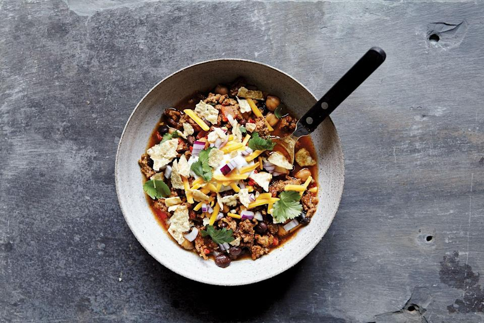 """This chili pleases all palates—it's not too spicy or too mild, but it's loaded with flavor. The best part of chili is the toppings, anyway—some sharp cheddar, a dollop of cumin-cilantro sour cream, and diced red onions are a must. <a href=""""https://www.epicurious.com/recipes/food/views/slow-cooker-beef-and-two-bean-chili?mbid=synd_yahoo_rss"""" rel=""""nofollow noopener"""" target=""""_blank"""" data-ylk=""""slk:See recipe."""" class=""""link rapid-noclick-resp"""">See recipe.</a>"""