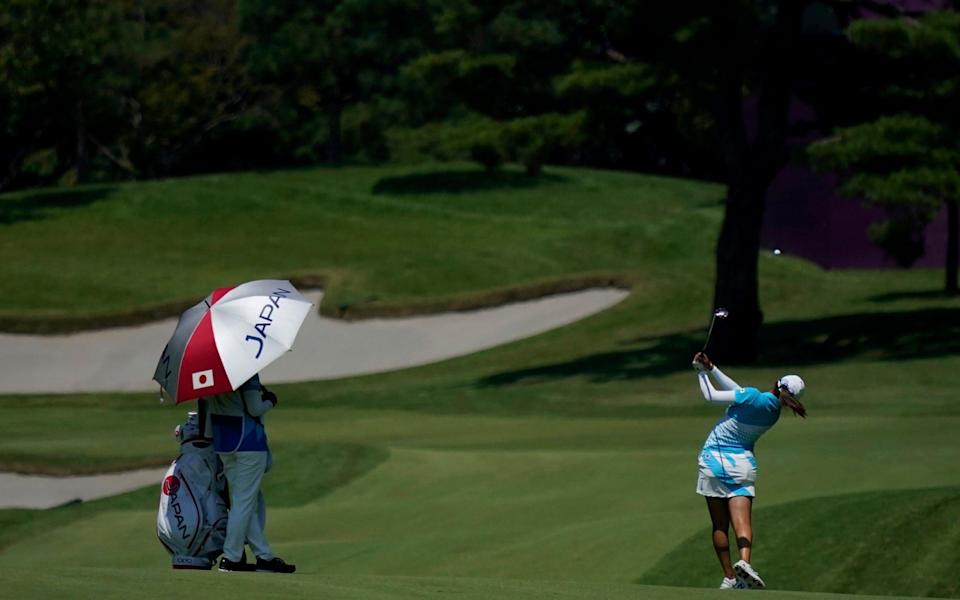 Mone Inami, of Japan,plays a shot from the 14th fairway during the third round of the women's golf event at the 2020 Summer Olympics. - AP Photo/Matt York