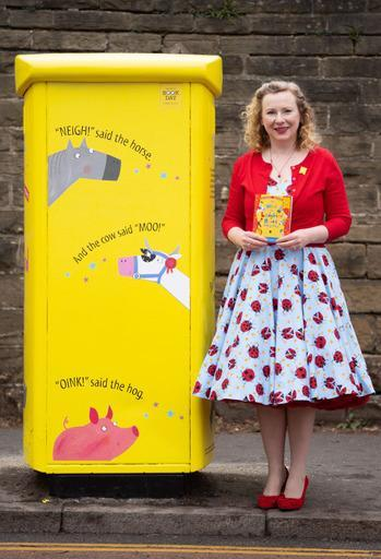 Lydia Monks with the parcel post box in Sheffield which honours her recent book with Julia Donaldson, What The Ladybird Heard (Royal Mail/PA)