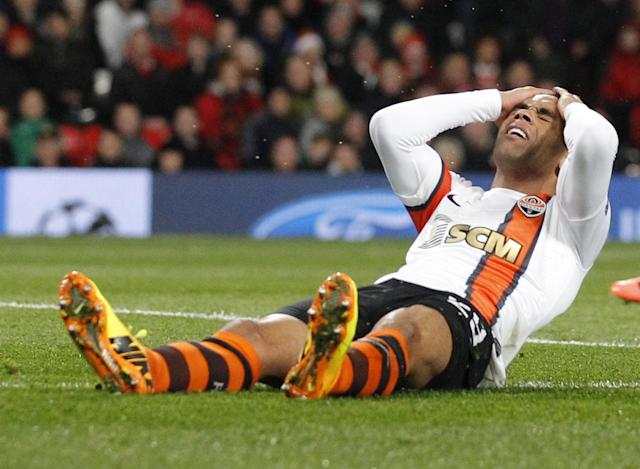 FILE - In this Tuesday, Dec. 10, 2013 file photo, Donetsk's Alex Teixeira reacts after missing a chance to score against Manchester United during their Champions League group A soccer match between Manchester United and at Shakhtar Donetsk at Old Trafford Stadium, Manchester, England. Six South Americans - including Teixeira - have refused to return to Ukraine to play for their football club in Donetsk as conflict rages around the city, risking possible fines and suspensions for breach of contract. (AP Photo/Jon Super, File)